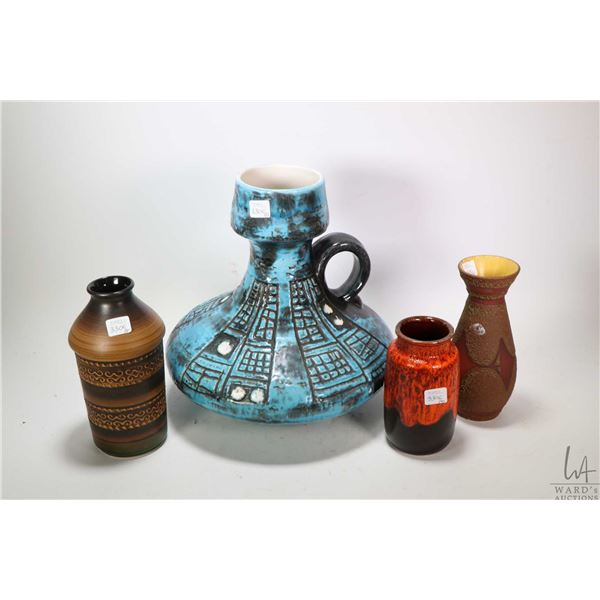 """Four pieces of mid century West German pottery including three vases and a 12"""" high handled jug"""