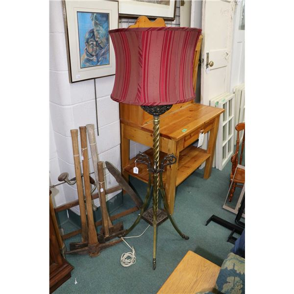 Antique converted electrified oil lamp with brass twist design and pierced font with decorative shad