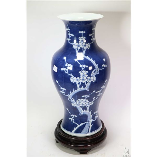 """Unmarked blue and white blossom motif porcelain vase 17"""" not including wooden plinth. Not Available"""
