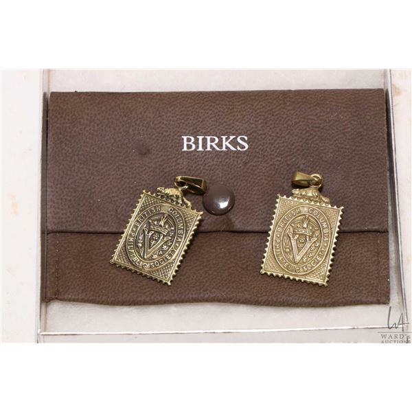 Two Birks metal British Columbia Philatelic Society metal medallions with Birks pouch