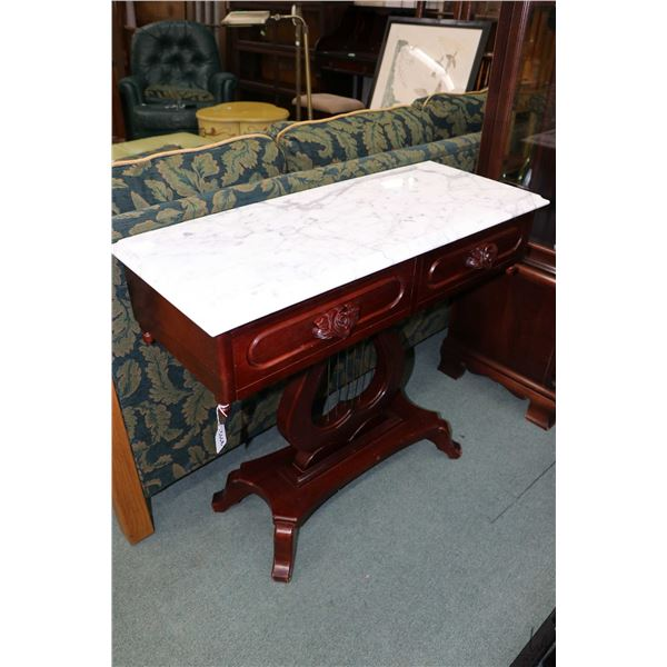 Semi contemporary antique style console table with marble top, floral motif drawer pulls and harp pe
