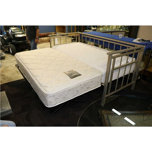 Modern metal framed single sized day bed with folding trundle which make to king sized with engaged,