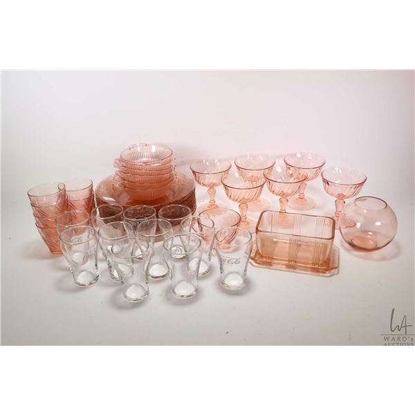 Selection of pink depression style glass including six sherbets, six nappies, eight plates, butter d