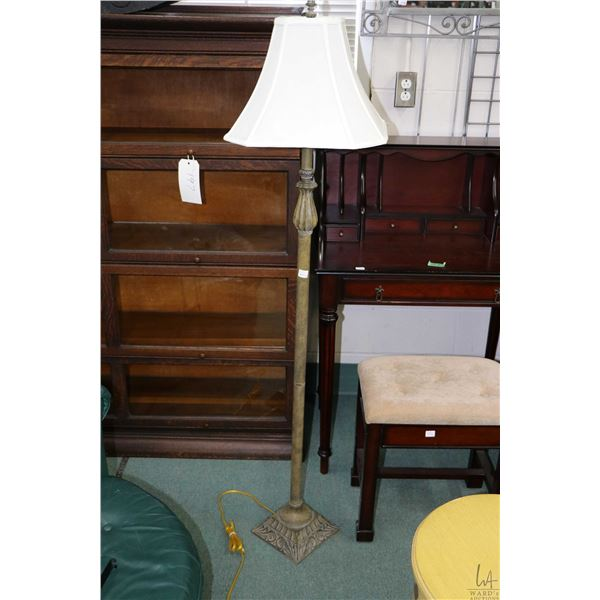 Contemporary floor lamp with rustic style finish and a metal framed wall mirror, outside dimensions