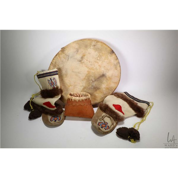 Selection of native hand crafts including skin drum, beaded mukluks and a bark basket