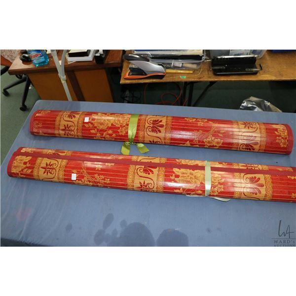 Two Oriental motif wooden floor mats
