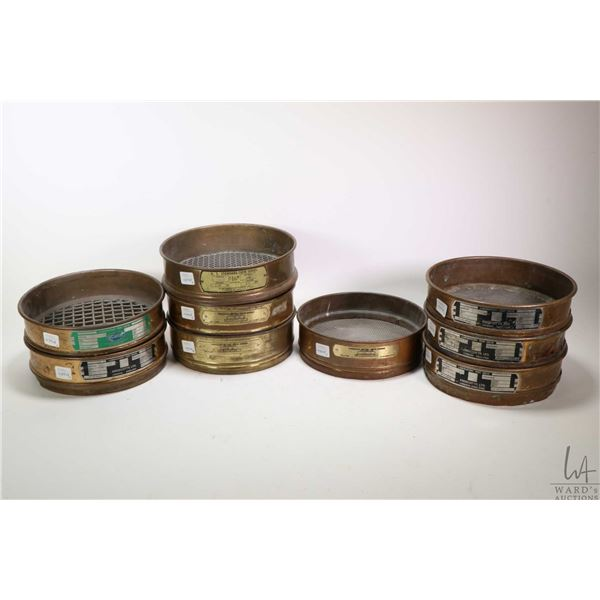 Nine test sieves, assorted sizes and assorted brands including Dual Manufacturing Co. and Endecotts