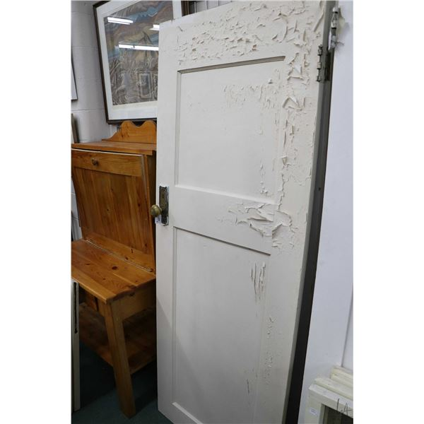 """Three antique raised panel doors, each with knobs and latches, approximately 77 1/2"""" X 30"""""""