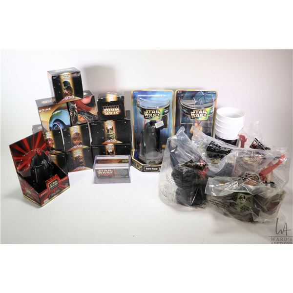Selection of new in box Star Wars collectibles including restaurant collectibles: Levitating Queen,