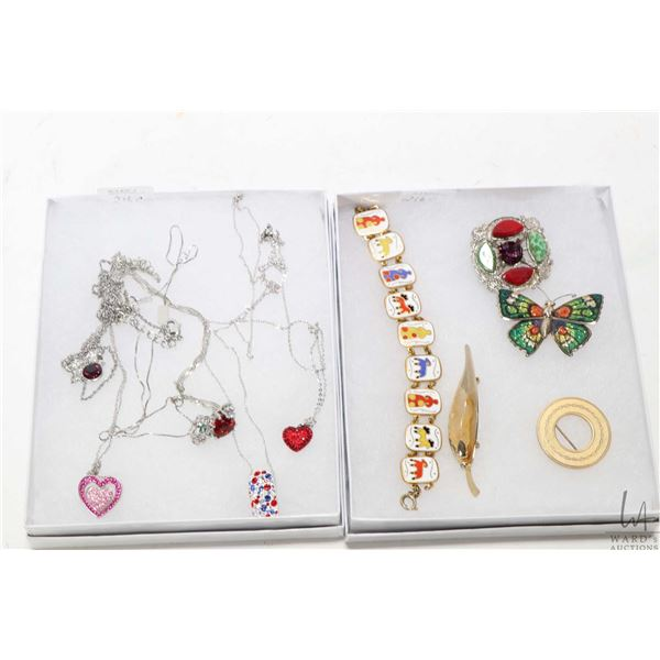 Selection of jewellery including enamelled bracelet, brooches, plus a selection of neck chains and p