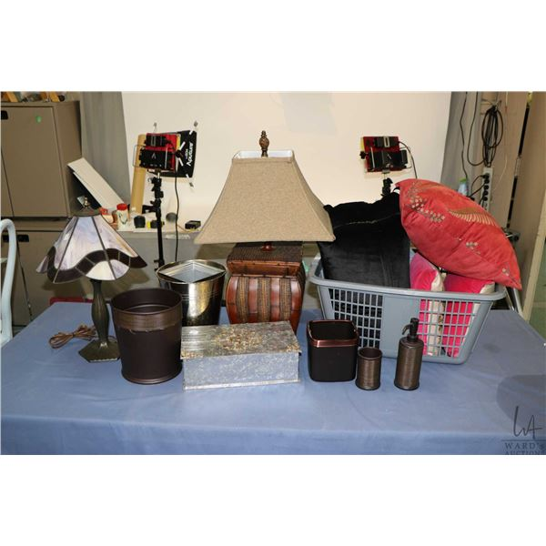 Selection of decor items including throw pillows, two non-matching lamps, garbage can, soap dispense