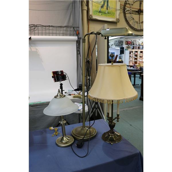 Two non-matching brass table lamps and a floor standing Verilux floor lamp with Optics glare control