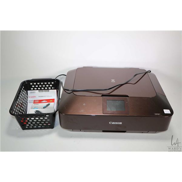 Canon MG7120 photo printer with owner's manual and four replacement inks, not tested at time of cata