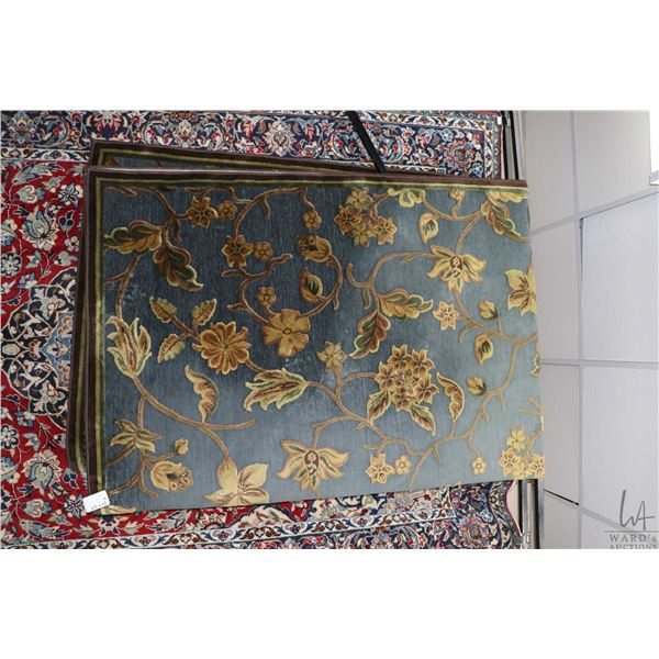 """Sculpted modern wool area carpet with blue background and gold and taupe flowers, 84"""" X 124"""""""