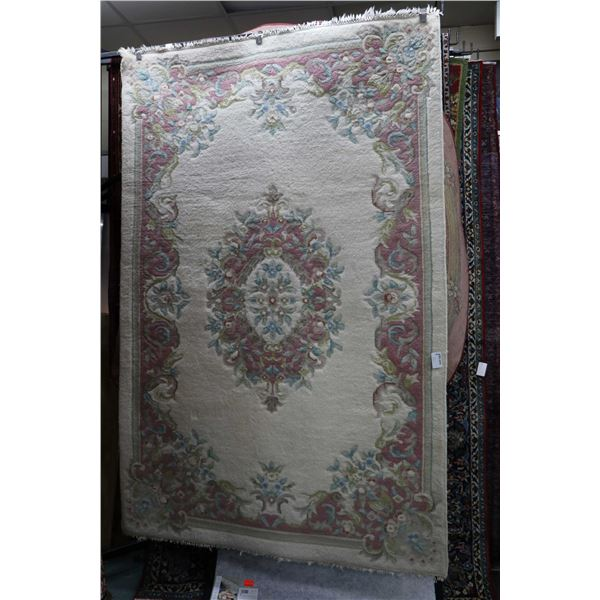India made 60% wool, 40% cotton area carpet with center medallion, cream background in soft tones of