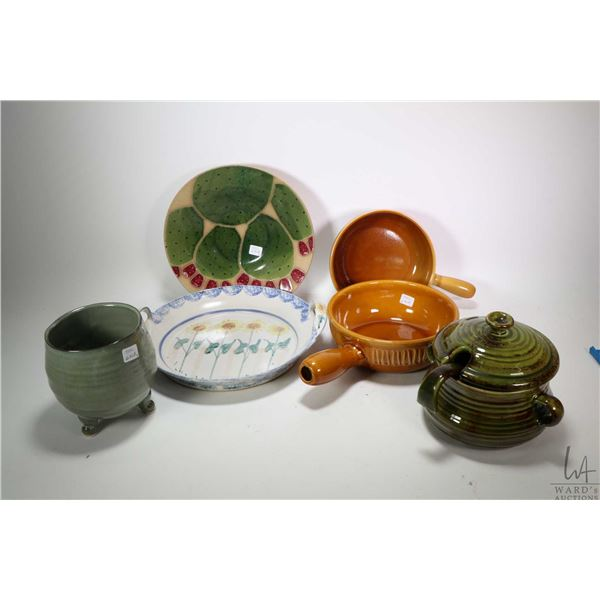 Selection of glazed pottery including handled dishes, lidded tureen with ladle, hand signed bowl etc