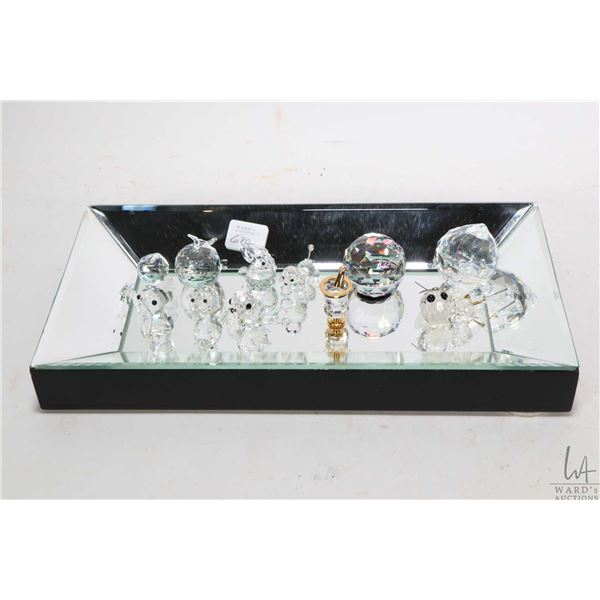 Mirrored tray with a selection of small Swarvoski crystals including animals, apple, Alberta sphere