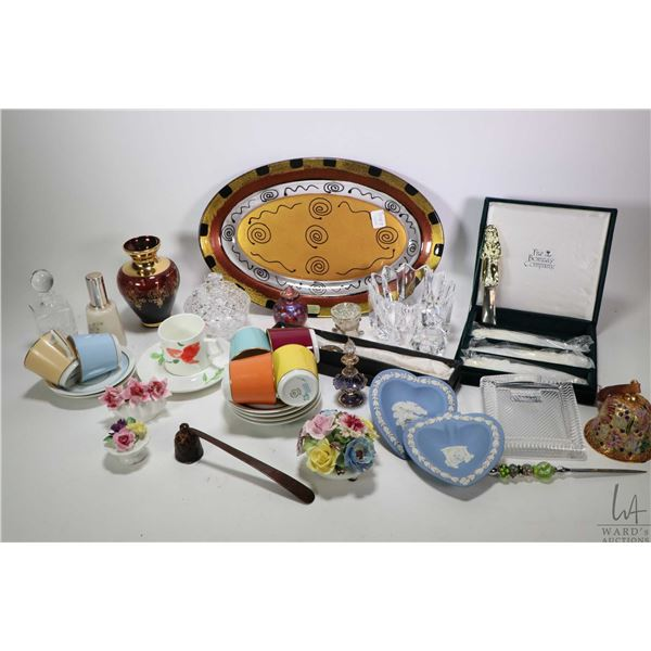 Selection of glass and porcelain collectibles including porcelain florals, perfumes, Wedgwood, six R