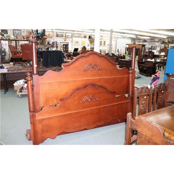 King sized four poster bed with attached carved decoration including headboard, footboard and rails
