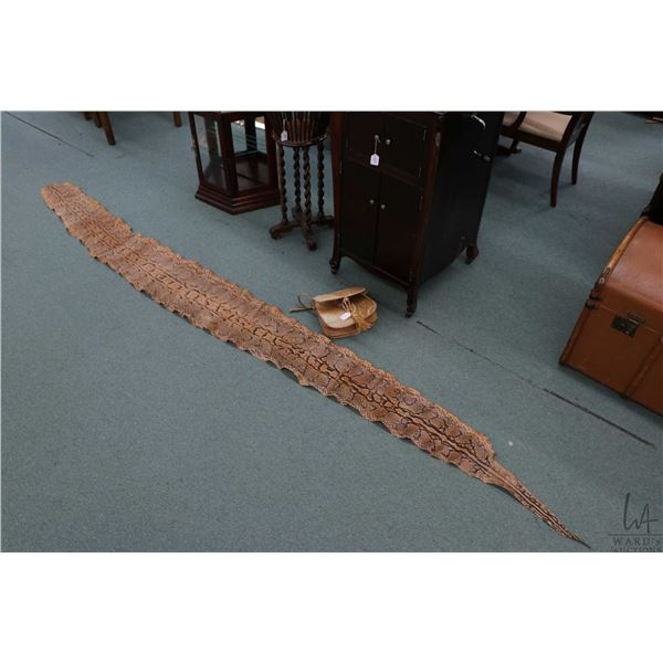 """Large snakeskin 11' 10"""" in length and a leather purse"""