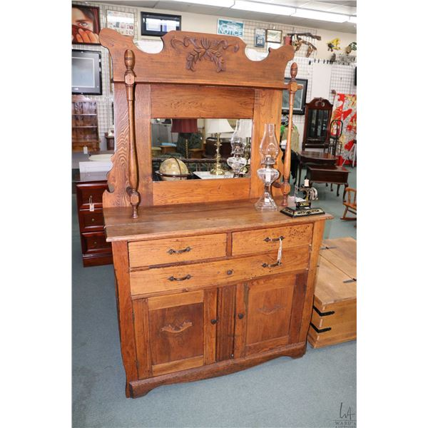 Antique primitive style, three drawer, two door sideboard with tall mirrored backboard