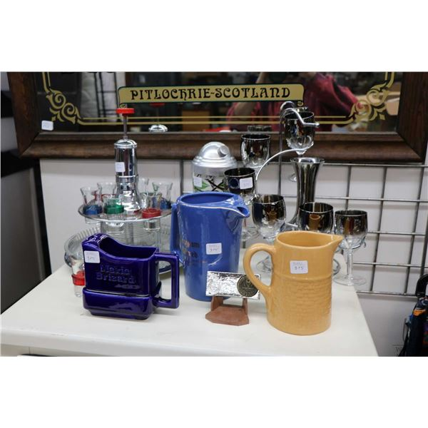 Selection of vintage and retro bar accessories including pitchers, shaker and two decanter and glass