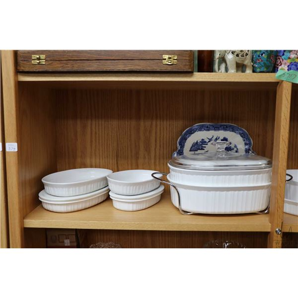 Shelf lot of kitchen collectibles including lidded casseroles, souffl' dish,  glass pitcher with fou