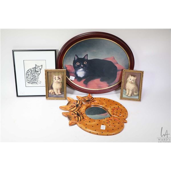 Selection of cat collectibles including wood framed mirror, framed prints etc.