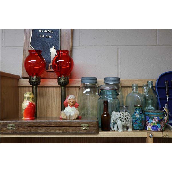 Shelf lot of collectibles including candleholders, vintage sealers, boxed flatware, vintage Noma Chr