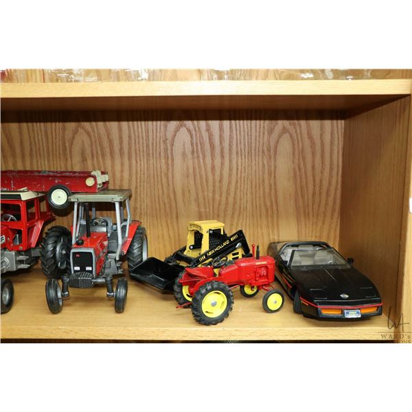 Shelf lot of vintage and collectible toys including tractors, ambulance, pick up truck, die cast, pr