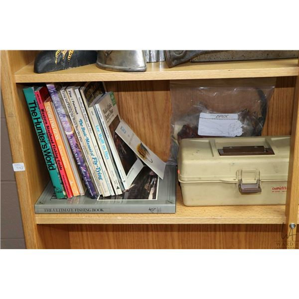Shelf lot including books on fishing, fly tying and outdoor activities, vintage tackle box and conte
