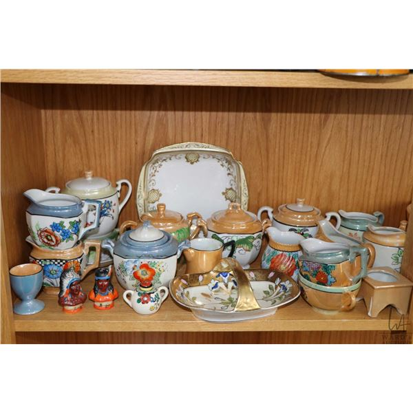 Shelf lot of collectibles including lustreware creamers and lidded sugars, teapots, etc.