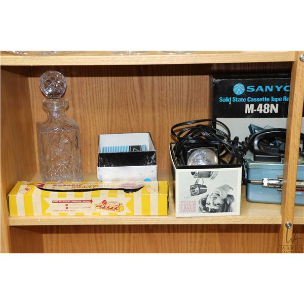 Shelf lot of vintage collectibles including crystal drinks decanter, Tower 6157 Geiger Counter, Lady