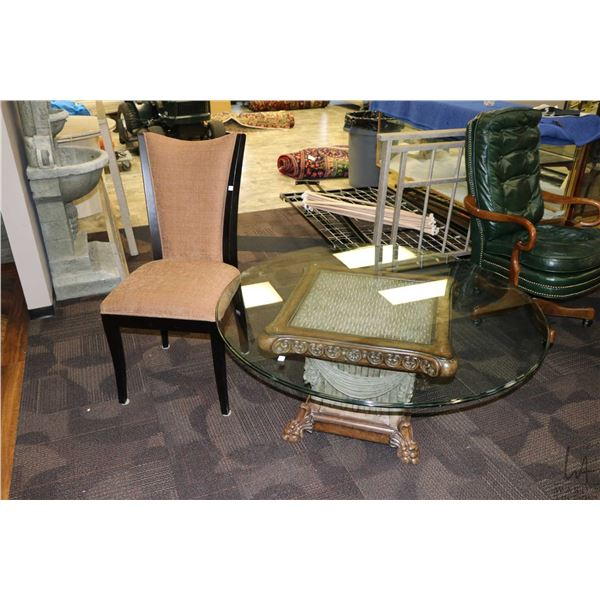 """Modern Romanesque style table base with 48"""" round glass top and an upholstered side chair"""