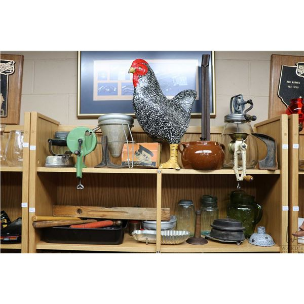 Two shelf lots of vintage kitchen collectibles including large rooster, bean pot, food masher, butte