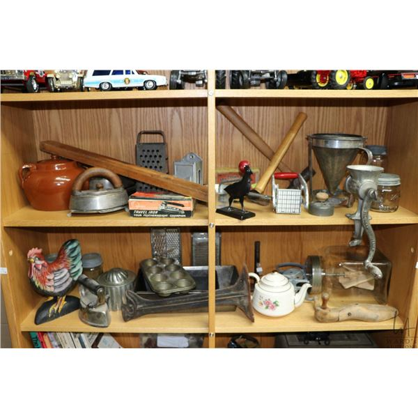 Two shelf lots of vintage kitchen collectibles including baking pans, teapot, chicken, irons, bean p