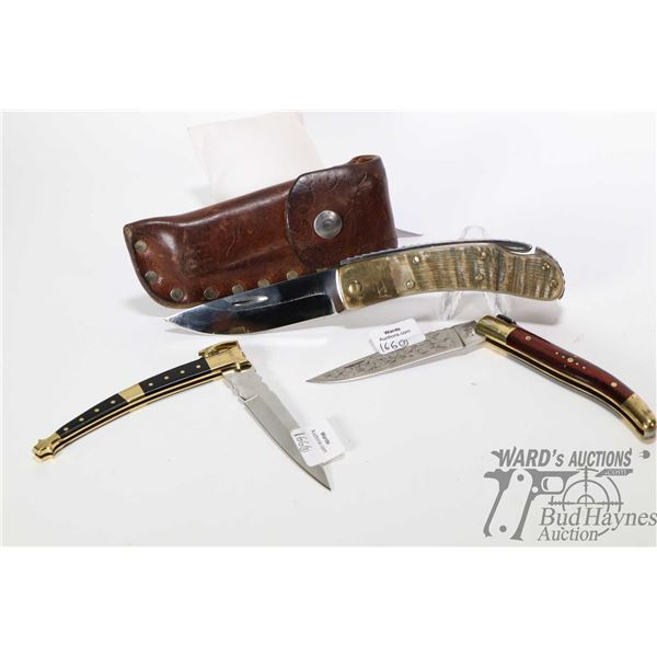 Three custom folding knives. One with antler handle, brass fittings and leather holster custom made