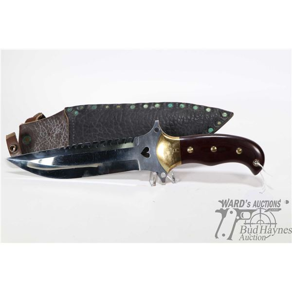 Large high quality custom made knife. Blade is sharp on both side and has a heart shaped cut out nea