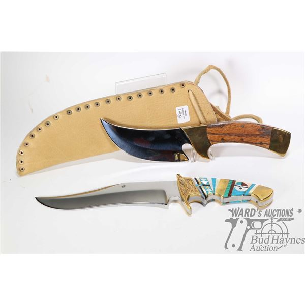 Two large custom knives including one with stylized handle and brass fittings and one with wooden ha