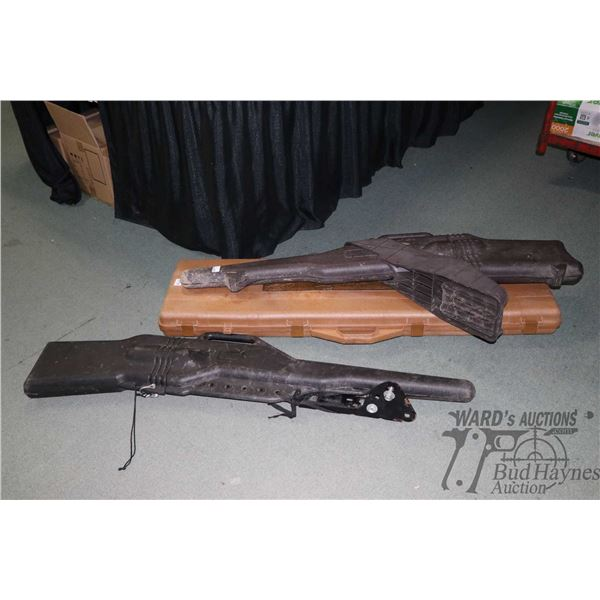 Large tan coloured hard rifle case and two ATV Large tan coloured hard rifle case and two ATV mounte