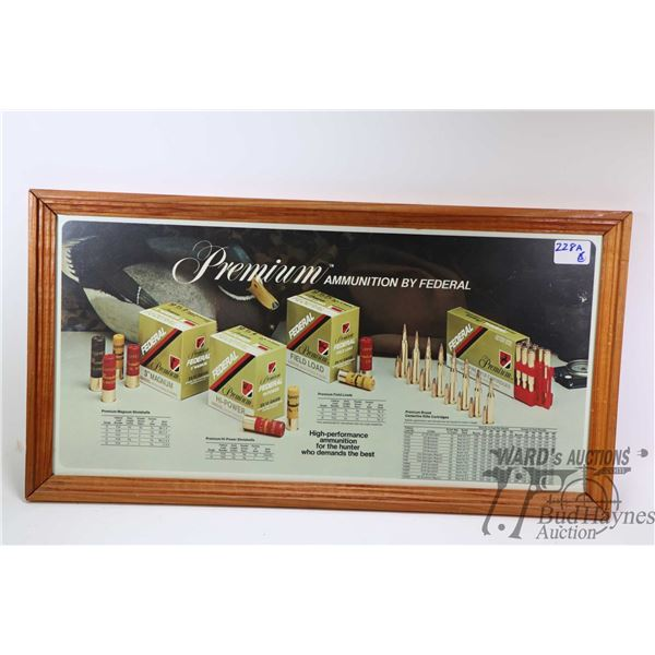 Three re-framed vintage firearms promotional Three re-framed vintage firearms promotional posters in