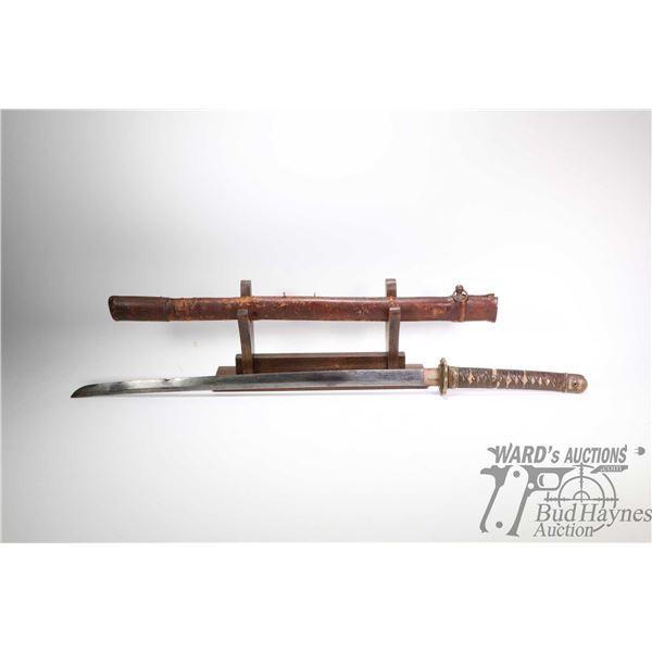 Japanese WWII era officers Shin Gunto sword. The Japanese WWII era officers Shin Gunto sword. The bl