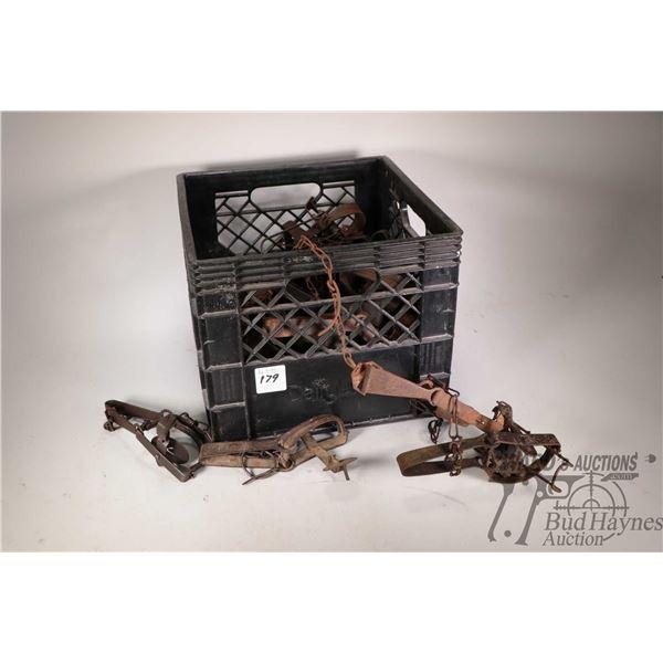 Approximately two dozen vintage leg hold traps