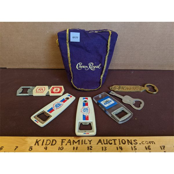 LOT OF 7 - VARIOUS COMMEMORATIVE BOTTLE OPENERS IN A CLASSIC CROWN ROYAL BAG