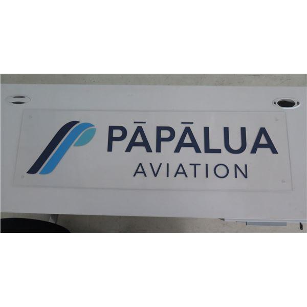 "White ""Papalua Aviation"" Logo Sign"