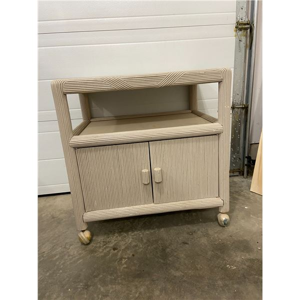 Vintage TV stand on casters