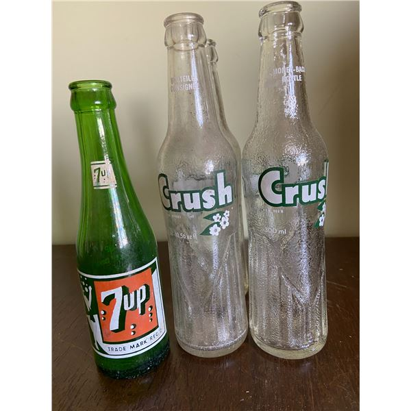 4 Crush pop bottles & 1 7-UP bottle