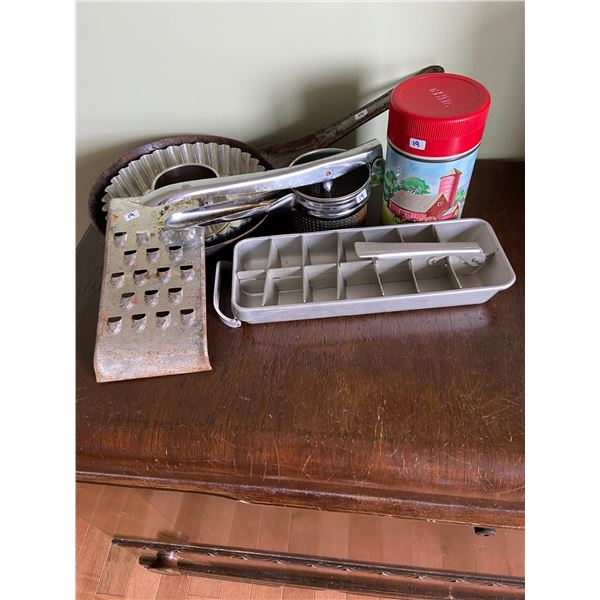vintage kitchen items including thermos