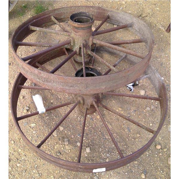 "2 large steel wheels 32"" high"