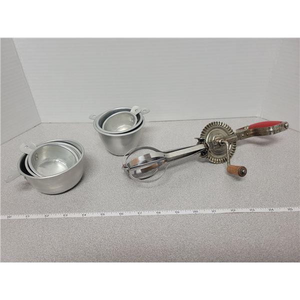 Taplin rotary egg beater & 2 sets aluminum measuring cups